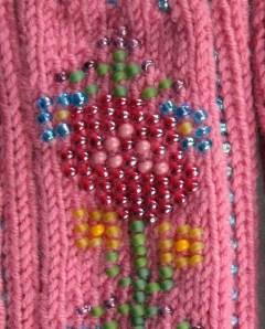 Bead Knitting used to embellish fingerless mittens.