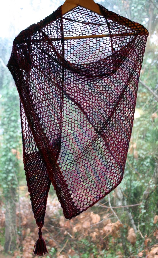 Faggotting combined with garter edges to keep it stable.  Amazingly large given that it only took about 325 meters.