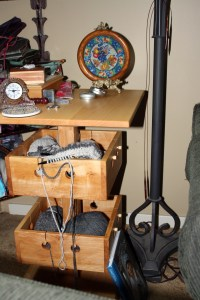 My new Knitting Table - note the needle hanging from the lamp in the background - no wonder I can never find anything!