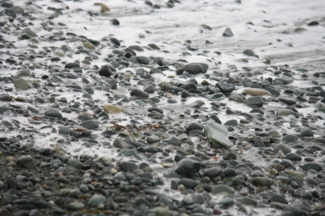 More shades of grey, pebbled with many coloured stones and hightlighted with silver foam.