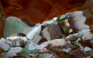 Beach glass behind glass