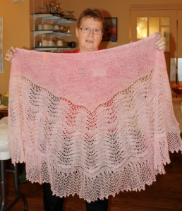 Anne displaying one of her lace shawls at the 2013 Retreat.