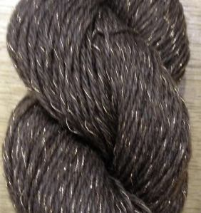 Our premier bison yarn. 100% Pure Bison Down at 17 wraps per inch twisted up with pure gold wrapped around silk, with just enough slack to make it work perfectly in knitted fabric, measuring 300 yd per 50 gram skein. Buffalo Gold is a 3-ply fingering-weight yarn ready for scarves and shawls that will become a heirloom in the making, intended to be worn for generations.   This is a special edition yarn, and probably will never be duplicated.