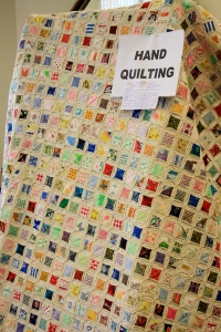 Every square a memory.  Each square was from a piece of clothing made by the quilters mother for her and her siblings - Priceless memories.