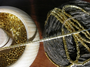 Spinning the beads onto the yarn.  Note the colour difference, evening light!
