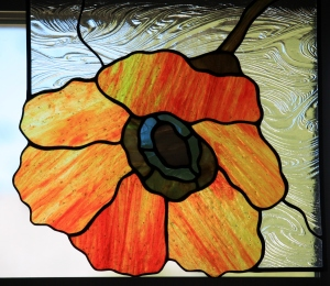 One of the Corner Poppies from Cheeky Monkey Glass Works!