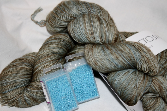 Mad Tosh Prairie, Cove Colourway, and beads - I see a shawl in its future!