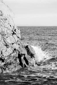 Waves crashing up against the rocks.