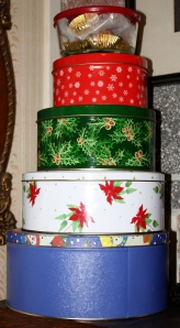 Stacks of Christmas tins filled with goodies.