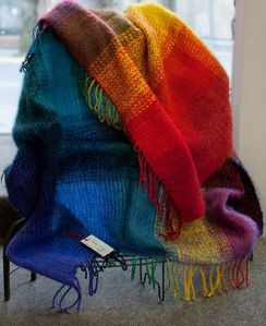 One of Melody's beautiful blankets made from local wool, spun and hand-dyed by Melody, and hand-dyed Mohair!  Warm and Cheerful.
