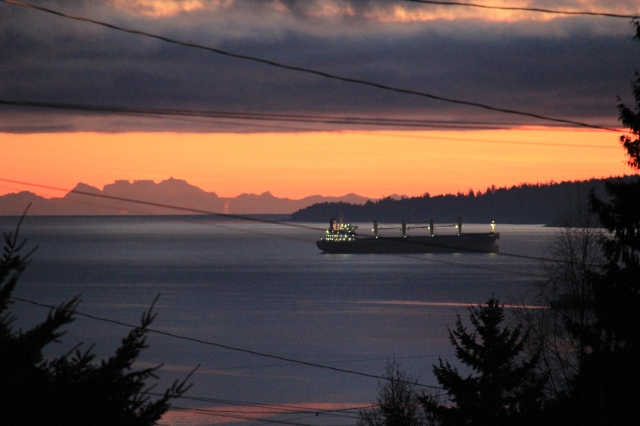 The view over to the Coastal Mountains - a tanker sits just outside the harbour ready to be unloaded or loaded.