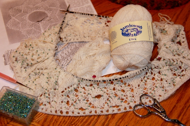 Liberally sprinkled with beads, knit with undyed Jamieson Ultra laceweight, and waiting to be painted.