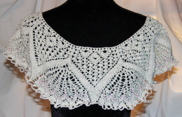 Such a pretty lace pattern!  Needs I-cord and tassel for the neck-line!