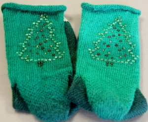 Donna's beaded Christmas socks - beads placed with a crochet hook.  Donna brought these to show me on Sunday.  The socks are her pattern with the beads placed from a chart  she had discovered - too cool!