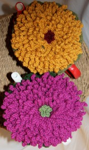Giant Mums grace the top of each cozy.