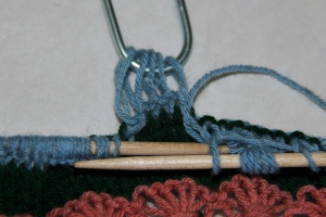 Slip next 5 sts to cable hook letting sts unravel as you slip them.