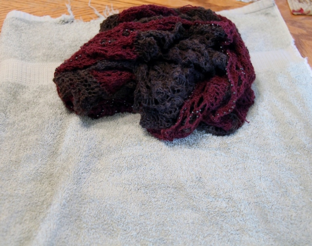 After gently squeezing - roll the shawl into a towel.